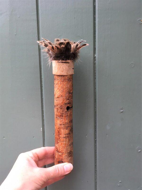 Birch bark vessel with turkey feather rim Ht 25 x 4 cms £42.00