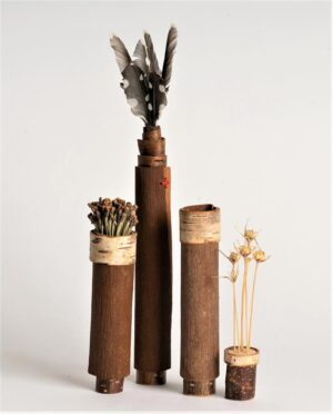 Eucalyptus bark pots with lids of feather and alium seeds Ht 24 x wdth 3 cms £ 38.00 each